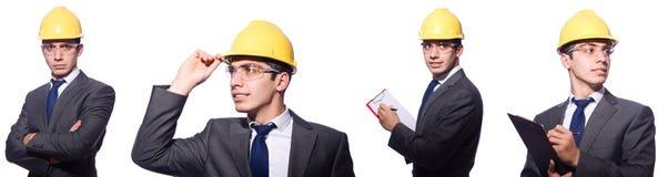 O capacete de segurança vestindo do homem isolado no branco Fotografia de Stock Royalty Free