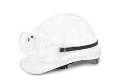 O capacete de segurança branco e googles Foto de Stock
