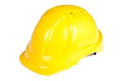 O capacete do construtor amarelo isolado no branco Foto de Stock