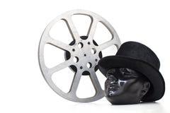 O carretel de filme de filmes velhos e da cabeça preta do manequim teve Imagens de Stock Royalty Free