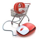 O carrinho de compras operou o rato do computador e o símbolo do comércio eletrônico Fotografia de Stock