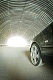 O carro vai na luz em um túnel Imagens de Stock Royalty Free