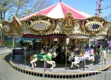 O carrossel alegre vai círculo Imagem de Stock Royalty Free