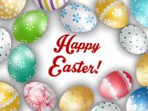 O cartão da Páscoa com cor eggs em um fundo branco Imagem de Stock