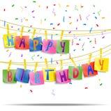 O cartão de aniversário com pregador de roupa e as letras coloridas penduram na corda Fotografia de Stock Royalty Free