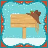 O cartão de Christmas do vaqueiro com chapéu ocidental e a madeira embarcam o fundo Fotografia de Stock