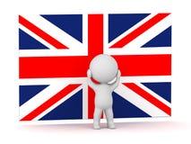 o caráter 3D é forçado na frente da bandeira britânica Union Jack Imagens de Stock
