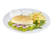 O cheeseburger com batata e molho fotografia de stock