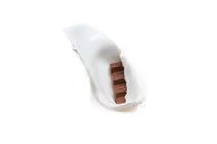 O chocolate cai dentro para ordenhar Imagem de Stock Royalty Free
