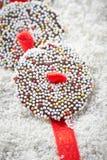 O chocolate do Natal polvilha Fotos de Stock