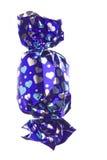 O chocolate no envoltório isolou-se Fotos de Stock Royalty Free