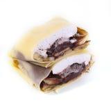 O chocolate, o creme e a banana no crepe da camada endurecem Imagens de Stock