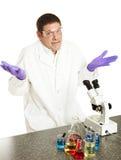 O cientista dá acima foto de stock