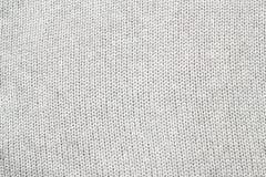 O cinza fez malha a tela feita do fundo/textura de várias cores do fio Fotos de Stock