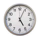 O'clock. 5:05 on the white wall clocks (isolated royalty free stock images