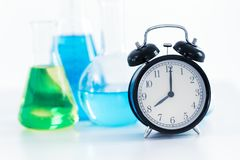 8 o`clock retro clock with Science Chemical medical research lab royalty free stock image