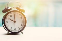 10 o`clock retro clock at the swimming pool stock image