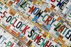 5 O`clock Somewhere; Recycled License Plates. Recycled into novel signage, these beautifully colored license plates can be in found tourist destinations Royalty Free Stock Photo