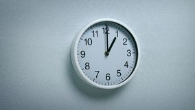 1 O`clock - wall clock moving shot. Generic clock on wall showing 1 o`clock tracking shot stock video footage