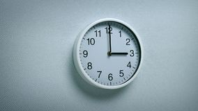 3 O`clock - wall clock moving shot. Generic clock on wall showing 3 o`clock tracking shot stock video footage