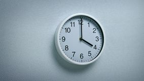 4 O`clock - wall clock moving shot. Generic clock on wall showing 4 o`clock tracking shot stock video