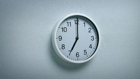 7 O`Clock - Wall Clock Moving Shot. Generic clock on wall showing 7 o`clock tracking shot stock video