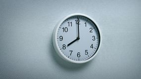 8 O`Clock - Wall Clock Moving Shot. Generic clock on wall showing 8 o`clock tracking shot stock video footage
