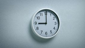 9 O`Clock - Wall Clock Moving Shot. Generic clock on wall showing 9 o`clock tracking shot stock footage
