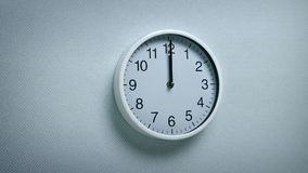 12 O`Clock - Wall Clock Moving Shot. Generic clock on wall showing 12 o`clock tracking shot stock video footage