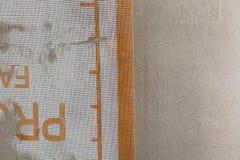 O close up da fachada mergulha sobre a malha, o emplastro e o cimento Imagem de Stock