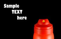 O Close-up do aerossol vermelho pode prover de bocal Imagem de Stock Royalty Free