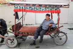 O cocheiro na cidade Fotografia de Stock Royalty Free