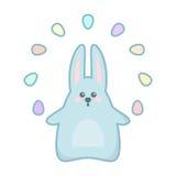 O coelhinho da Páscoa bonito manipula ovos coloridos Fotos de Stock