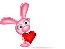 O coelho bonito guardara o coração do amor Fotografia de Stock Royalty Free