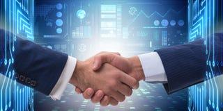 O conceito da cooperação do negócio com agitação de duas mãos Imagens de Stock Royalty Free