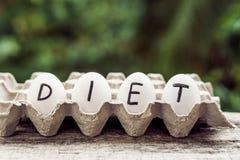 O conceito da dieta Ovos dietéticos em um recipiente Imagem de Stock