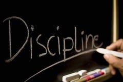 O conceito da disciplina, a inscrição no fundo de foto de stock royalty free