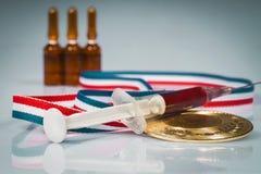 O conceito da lubrificação e ferimento no esporte Foto de Stock