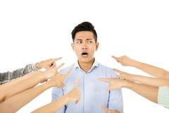 O conceito de acusa o homem novo culpado imagem de stock