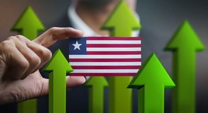 O conceito do crescimento da nação, esverdeia acima das setas - homem de negócios Holding Car ilustração stock
