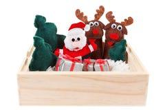 O conceito do Natal brinca em uma caixa de madeira com neve no branco Foto de Stock Royalty Free