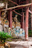 O condado de Anyue, província de Sichuan no templo da caverna do pavão da dinastia de música do norte criou a caverna da Buda trê Imagem de Stock