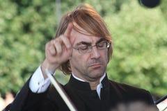 O condutor da orquestra sinfônica do mastrangelo de Fabio do museu de eremitério do estado (St Petersburg) (Italia) Fotografia de Stock