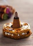 O cone do aroma em um suporte com aroma cola Fotografia de Stock
