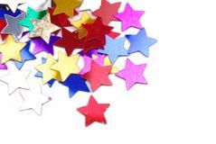 O confete stars o fundo da beira Fotografia de Stock Royalty Free