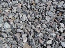 O contexto das pedras cinzentas do cascalho Fotografia de Stock