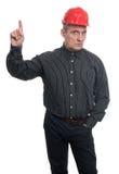 O coordenador no capacete aponta o dedo acima Fotografia de Stock Royalty Free
