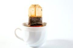 O copo do chá com saquinho de chá retira Fotos de Stock