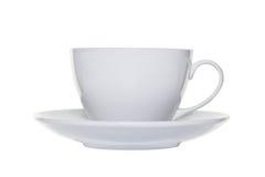 O copo e o saucer de chá brancos cortaram foto de stock royalty free