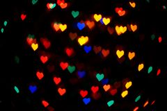 O coração deu forma ao fundo das luzes fotos de stock